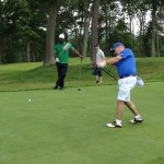 Players on the green during The Second Annual Big Daddy Golf Classic at Oheka Castle.