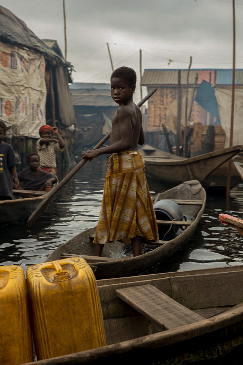 Nigerian School Project.Boy in boat at Makoko