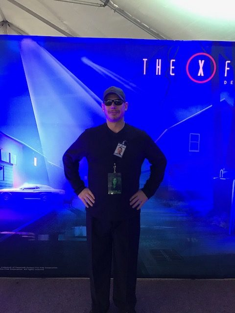 Michael at the X-Files Deep State Booth posed for us in front of their popular photo booth where fans gathered to take pictures during the event